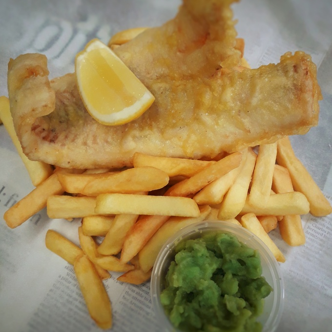 Battered Haddock, chips and mushy peas